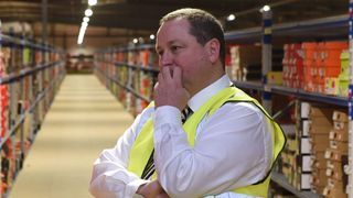 Sports Direct founder Mike Ashley in the picking warehouse at the firm's headquarters in Shirebrook, Derbyshire
