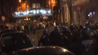 Police charge England fans in Lille.