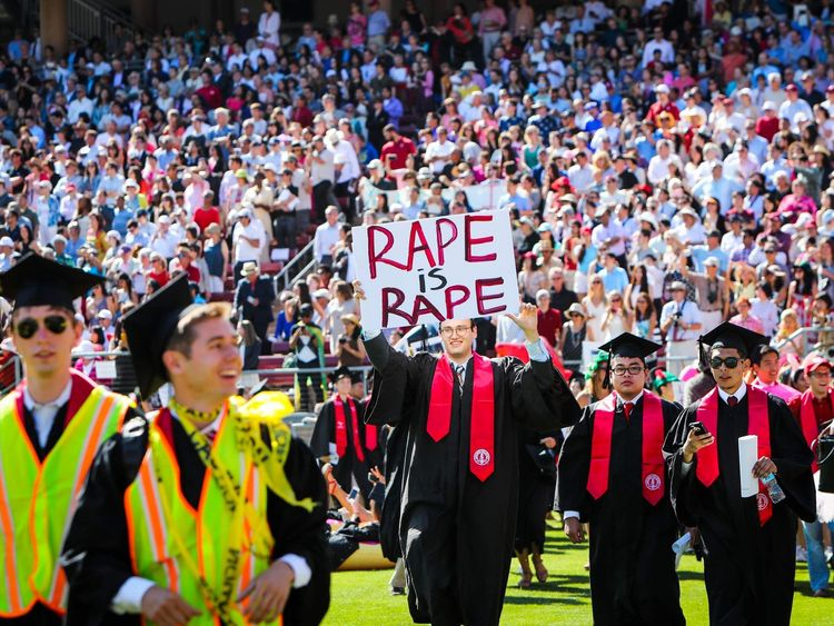 carries a sign in a show of solidarity for a Stanford rape victim during graduation ceremonies at Stanford University