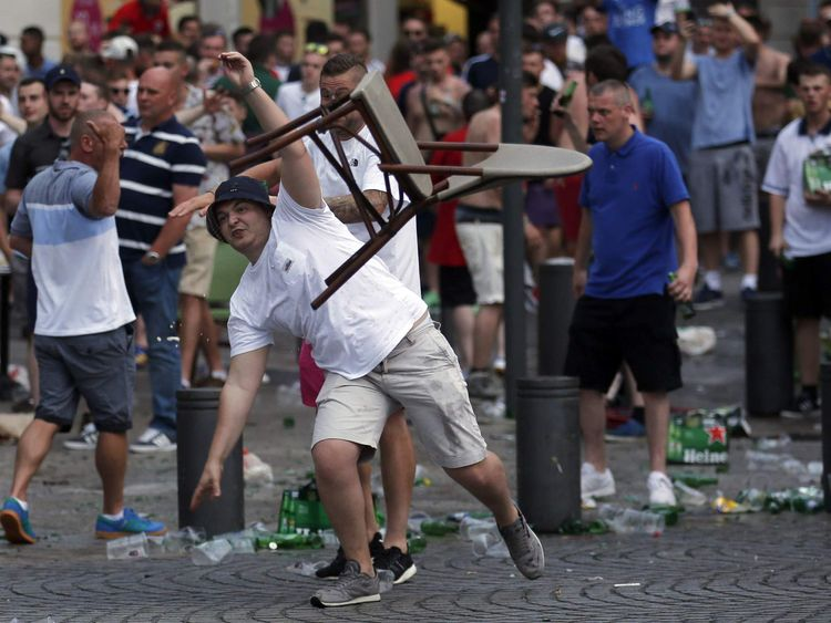An England fan hurls a chair ahead of England's EURO 2016 match in Marseille