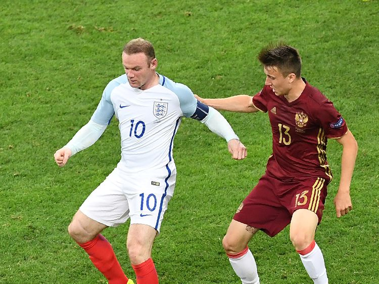 England's forward Wayne Rooney (L) vies with Russia's midfielder Aleksandr Golovin during the Euro 2016 group B football match between England and Russia a