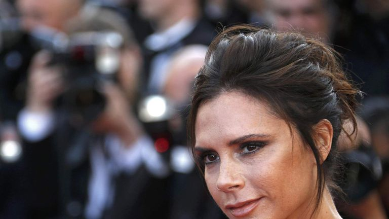 "Fashion designer, model and singer Victoria Beckham poses on the red carpet as she arrives for the opening ceremony and the screening of the film ""Cafe Society"" out of competition during the 69th Cannes Film Festival in Cannes"