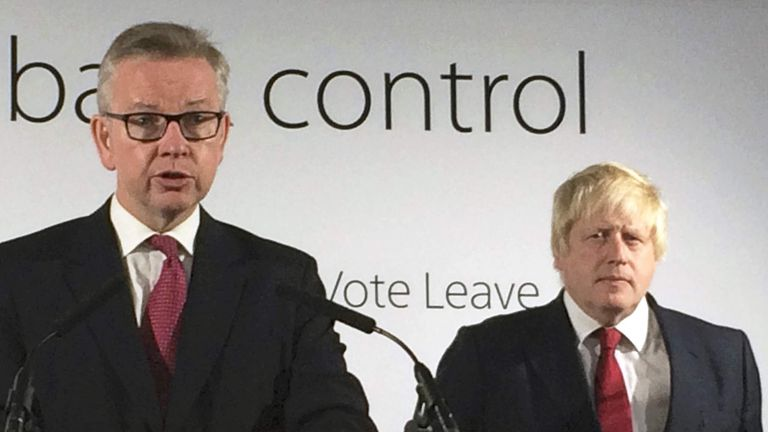 Britain's Justice Secretary Michael Gove speaks as Vote Leave campaign leader Boris Johnson listens at the group's headquarters in London