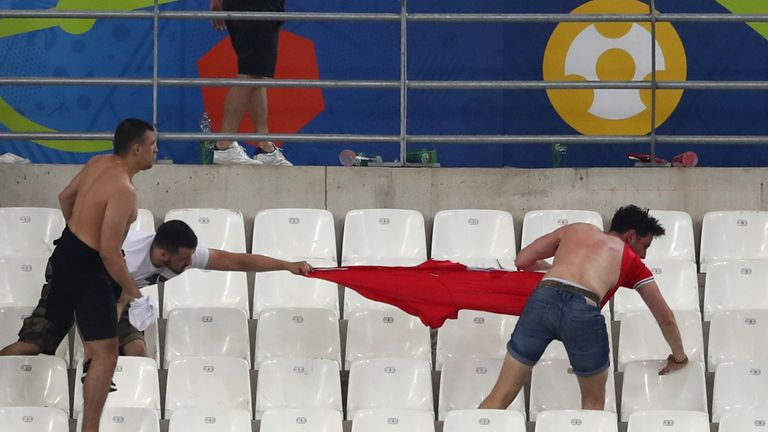 Fans clash after the match between England and Russia at Stade Velodrome