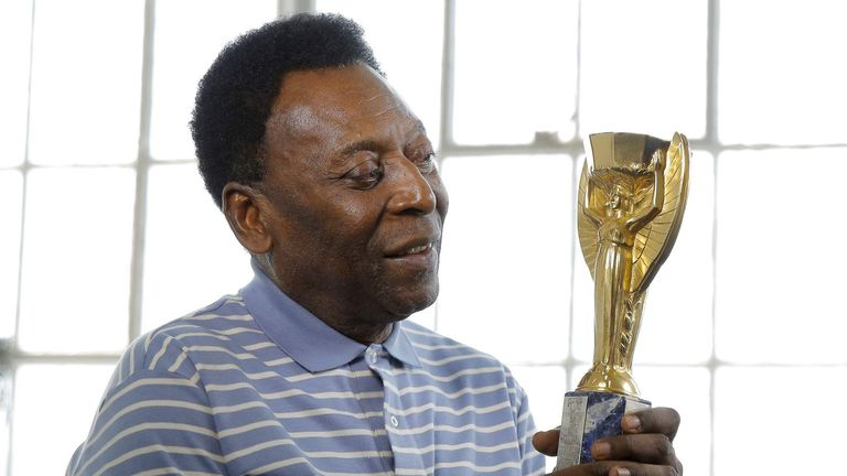 Pele with his 1958 World Cup replica trophy
