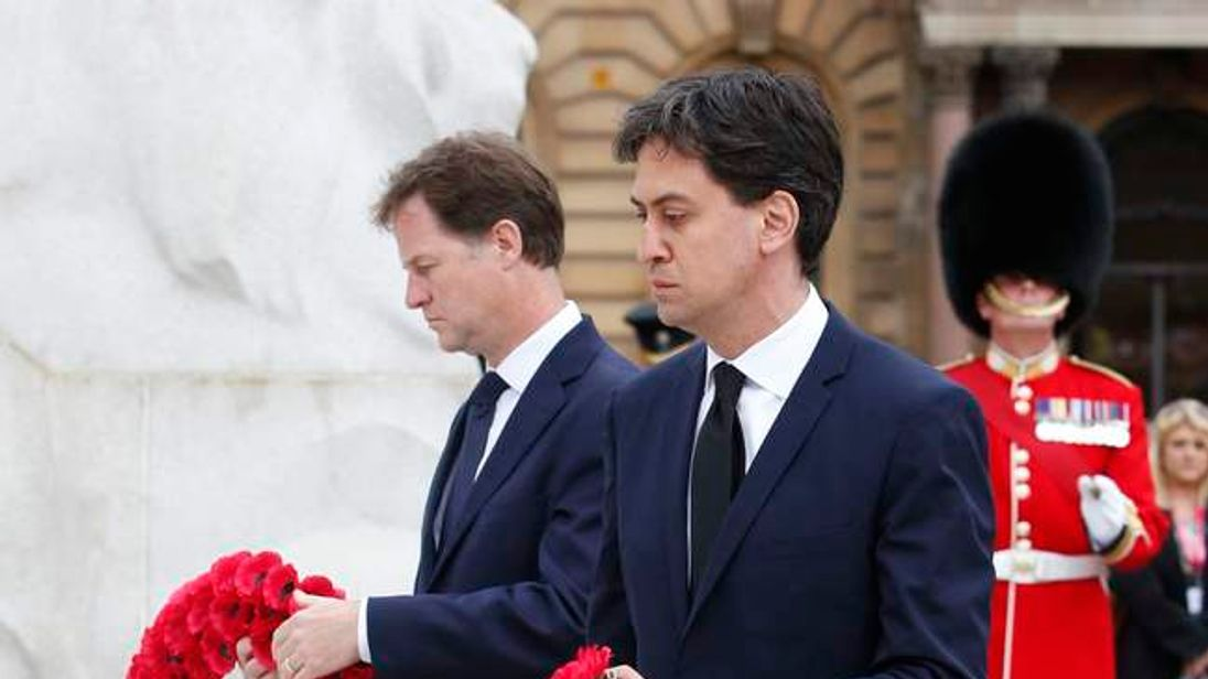 Deputy Prime Minister Nick Clegg and Labour leader Ed Miliband during a wreath-laying ceremony at the cenotaph in Glasgow