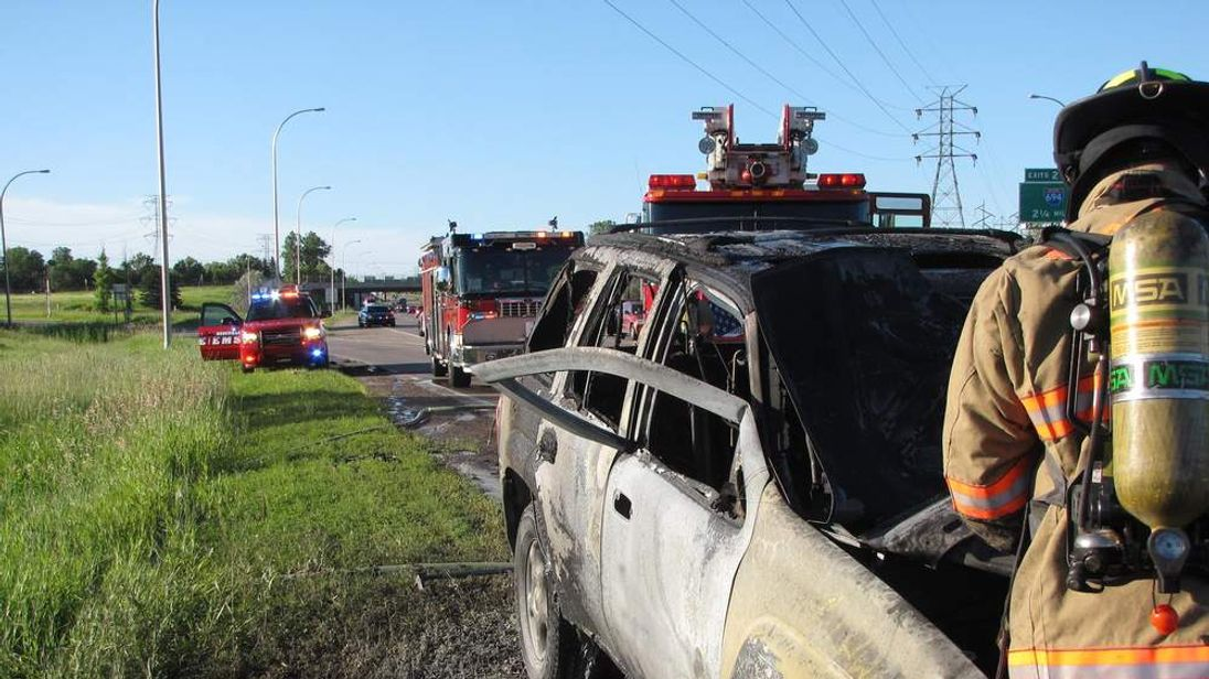 The aftermath of a car fire in Minnesota, in which a man bent down a door to save the driver