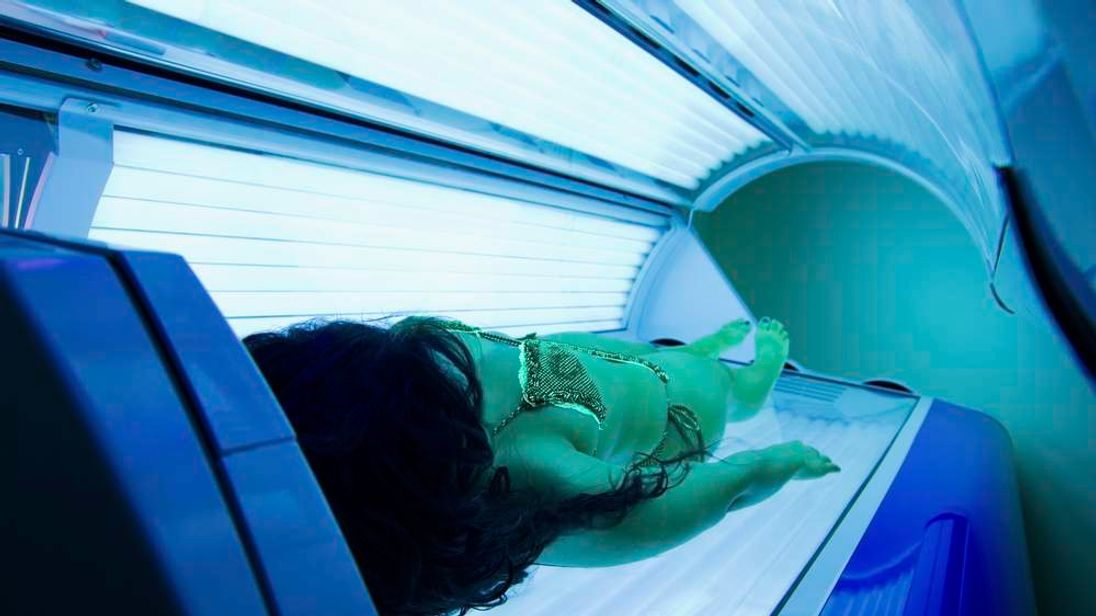 A woman on a sunbed
