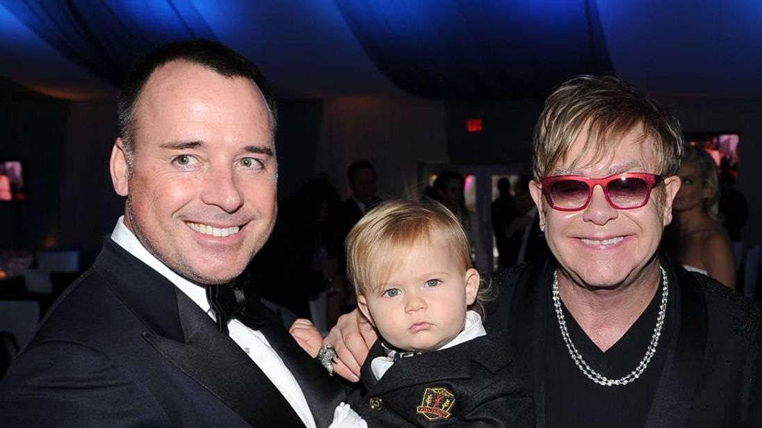 Sir Elton John and David Furnish (left) with their son Zachary