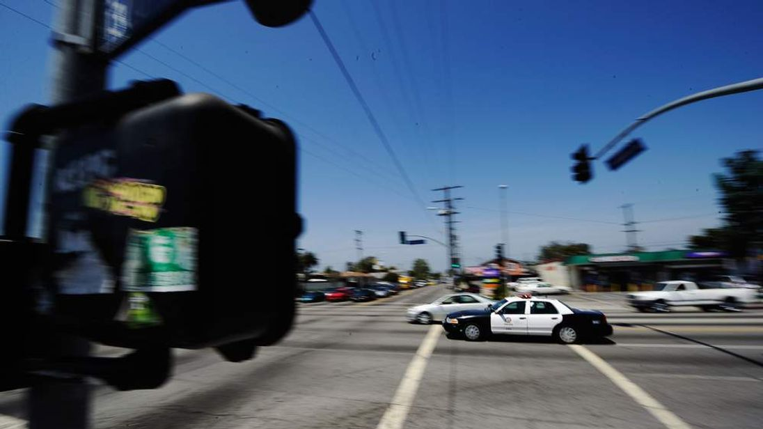 A Los Angeles Police Department car with its lights and sirens blaring in April 2012.