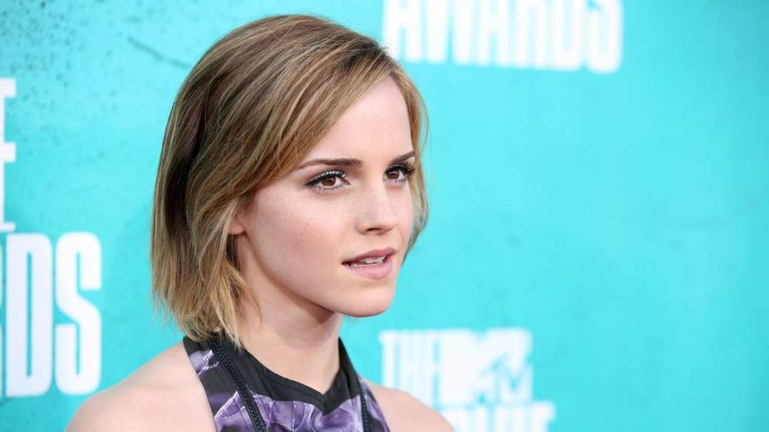 Actess Emma Watson arrives at the 2012 MTV awards