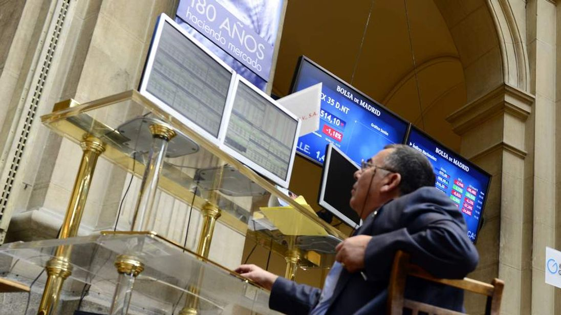 A trader looks at the IBEX-35 index billboard on June 18, 2012 at Madrid's stock exchange