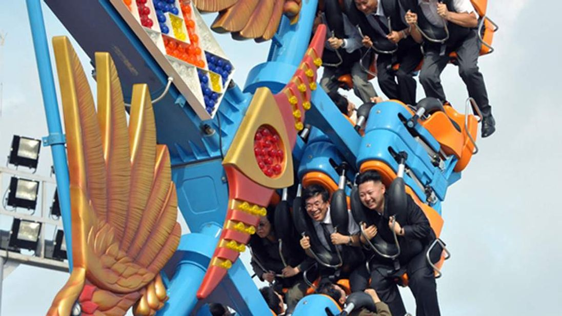 North Korean leader Kim Jong-Un enjoying a ride at the Rungna People's Pleasure Ground in Pyongyang.