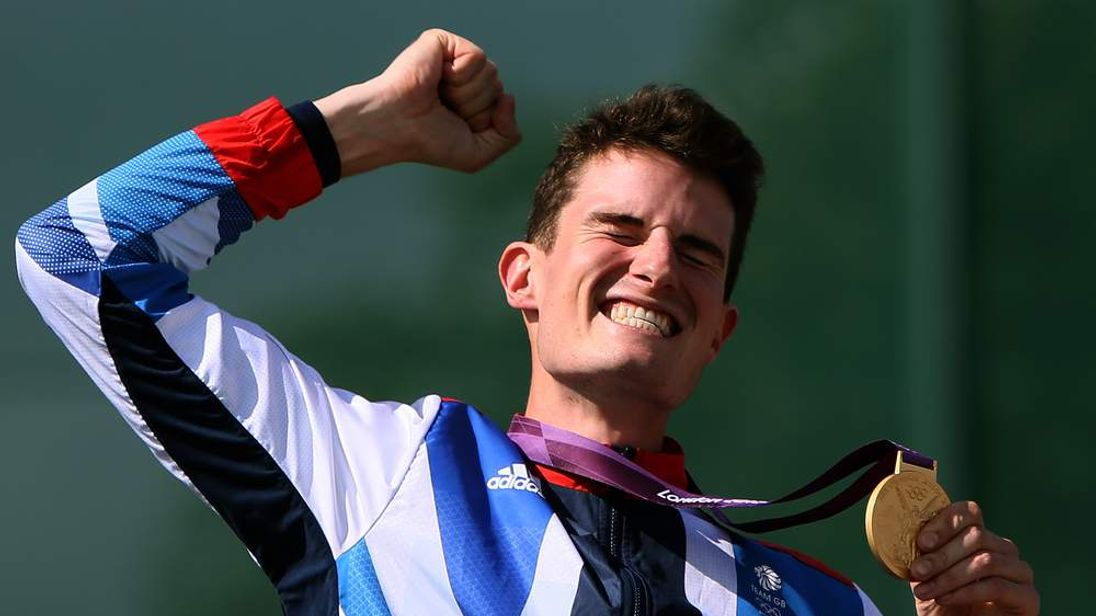 Great Britain's Peter Robert Russell Wilson celebrates on the podium with his gold medal after winning the men's shooting double trap final at the London 2012 Olympic