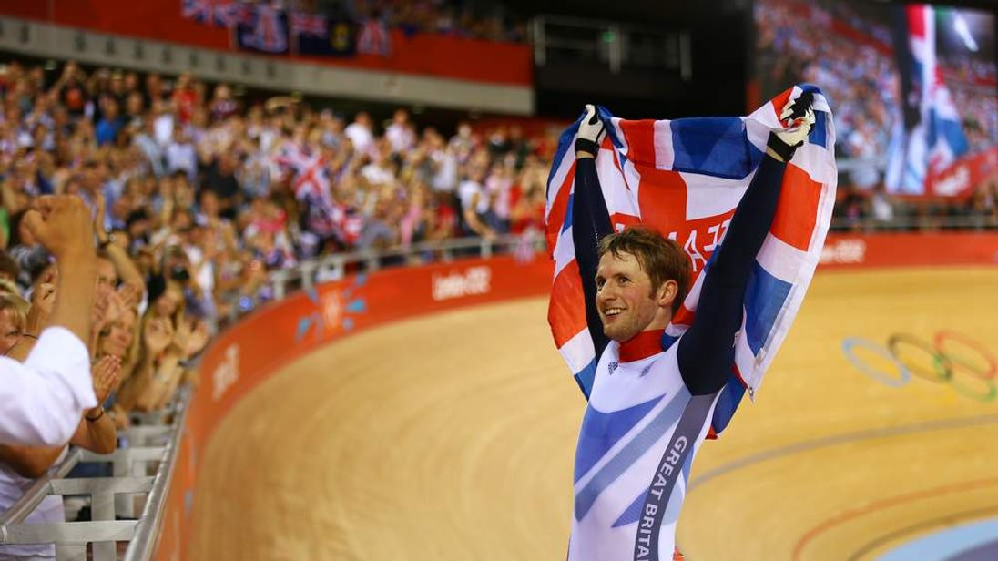 Jason Kenny of Great Britain celebrates winning the second heat against Gregory Bauge of France during the Men's Sprint Track Cycling Final and winning gold on Day 10 of the London 2012 Olympic Games at Velodrome on August 6, 2012 in London
