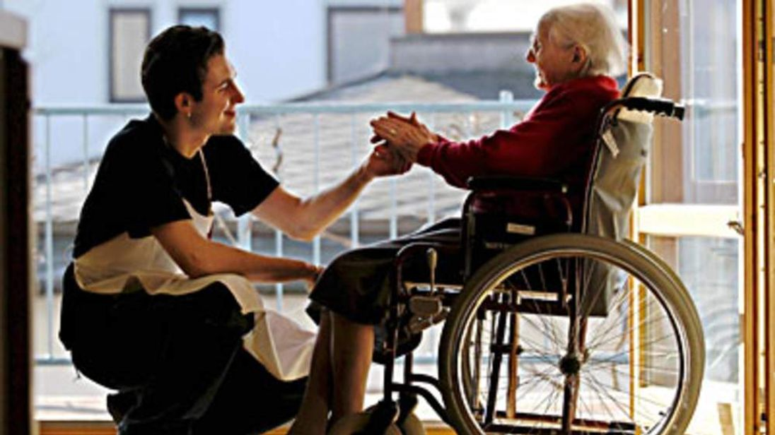 Carer with elderly woman