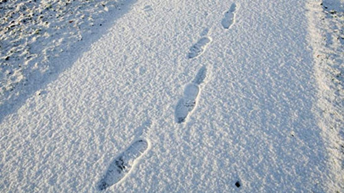 Footprints on a snow covered path