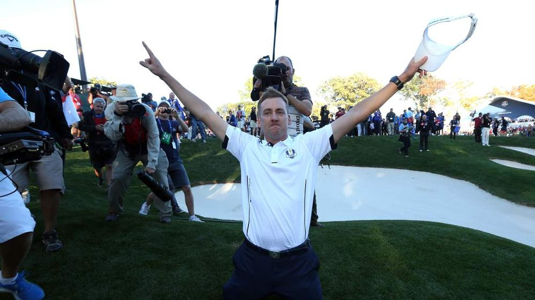 Ian Poulter poses by a bunker after the victory