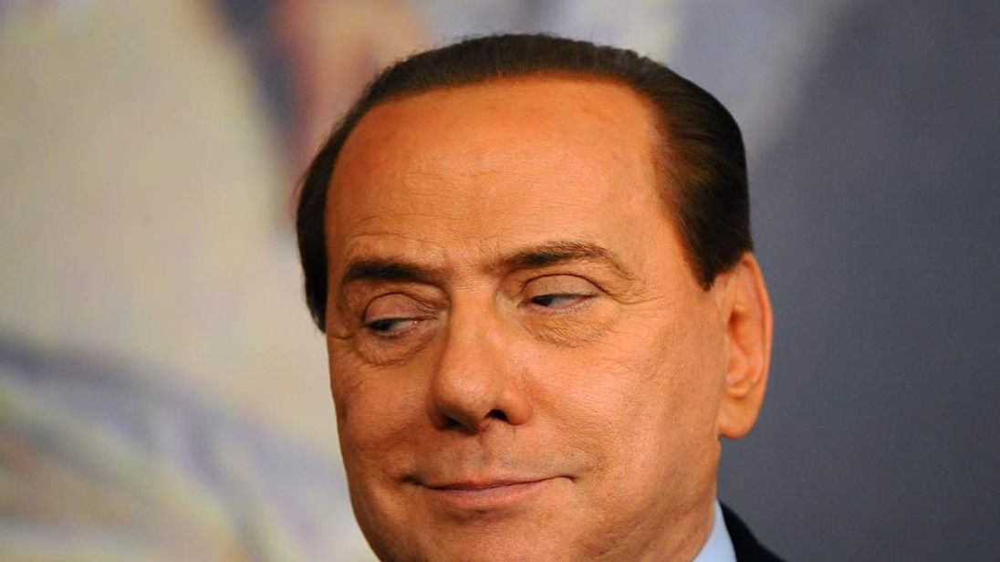 Silvio Berlusconi reacting during a press conference following an economic agreement for small and medium companies.
