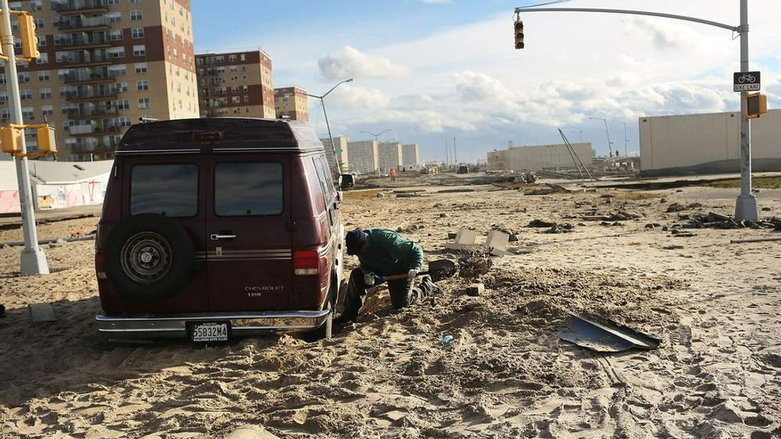 Damage is viewed in the Rockaway neighborhood where the historic boardwalk was washed away during Hurricane Sandy