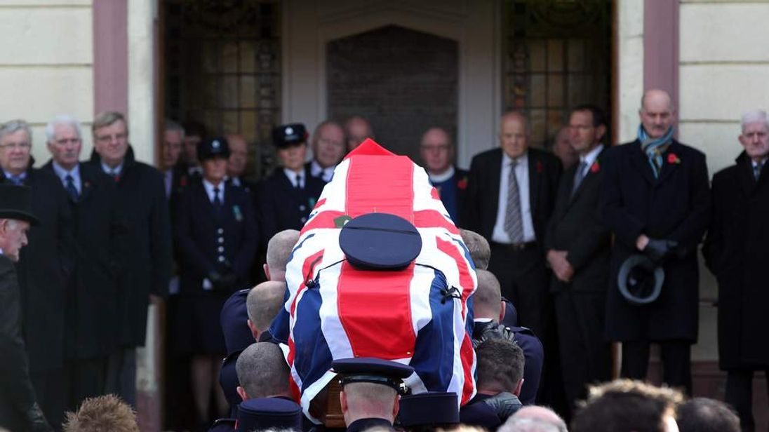 Prison officers carry the coffin of colleague David Black, 52, who was shot dead on the M1 motorway as he was driving to work