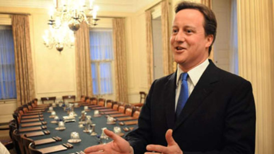 David Cameron in an empty Cabinet room