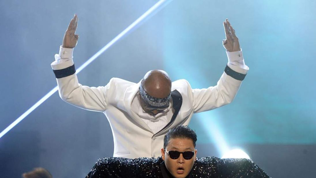 MC Hammer and singer PSY perform onstage