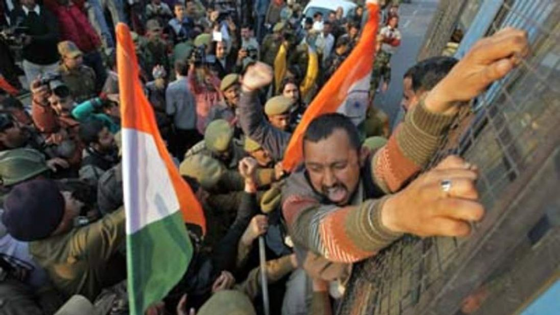 A supporter of BJP shouts as he is been detained by police during a protest near the airport in Jammu