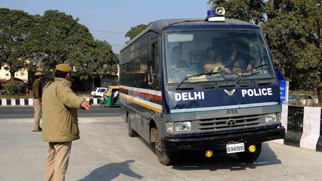 A prisoner transport vehicle arrives at Saket District Court in Delhi, India