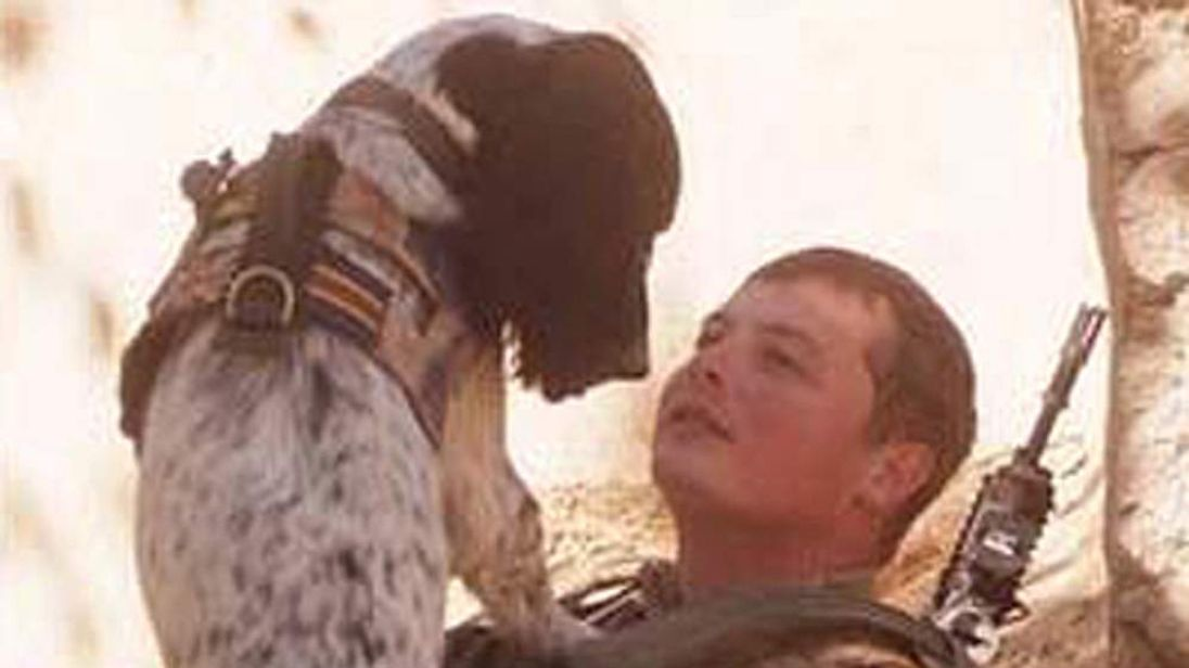 Dog handler Lance Corporal Liam Tasker and his springer spaniel Theo (MoD)