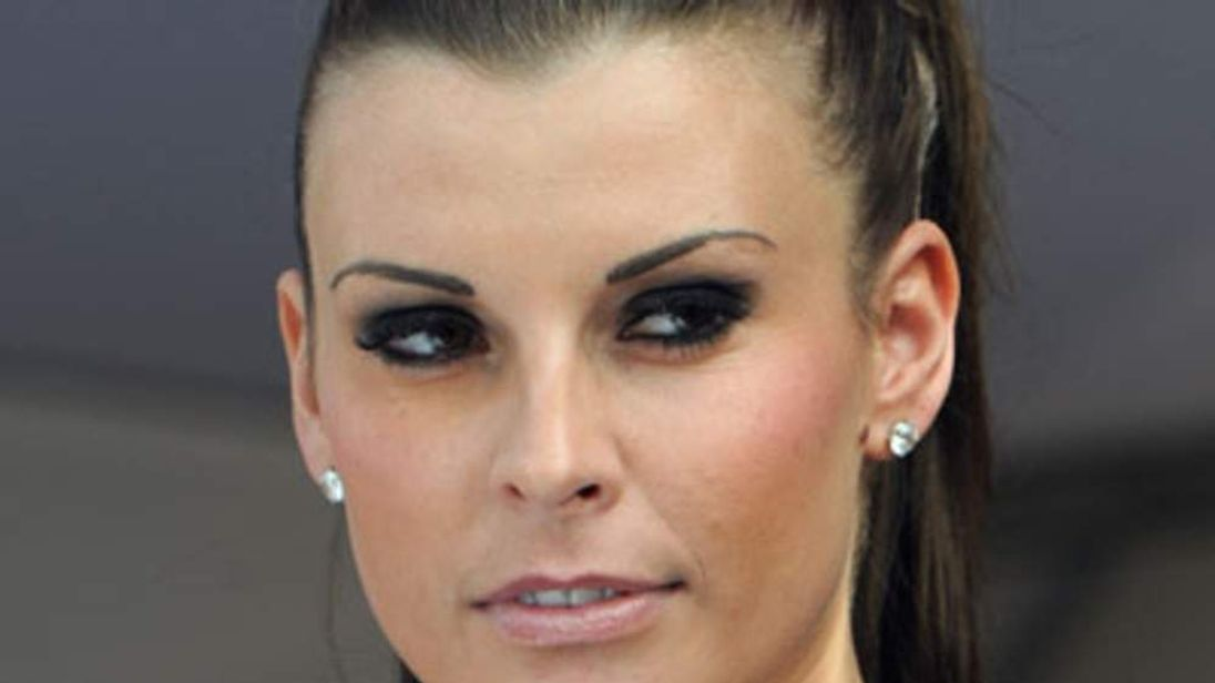 Coleen Rooney at last year's Ladies' Day at the Aintree racecourse