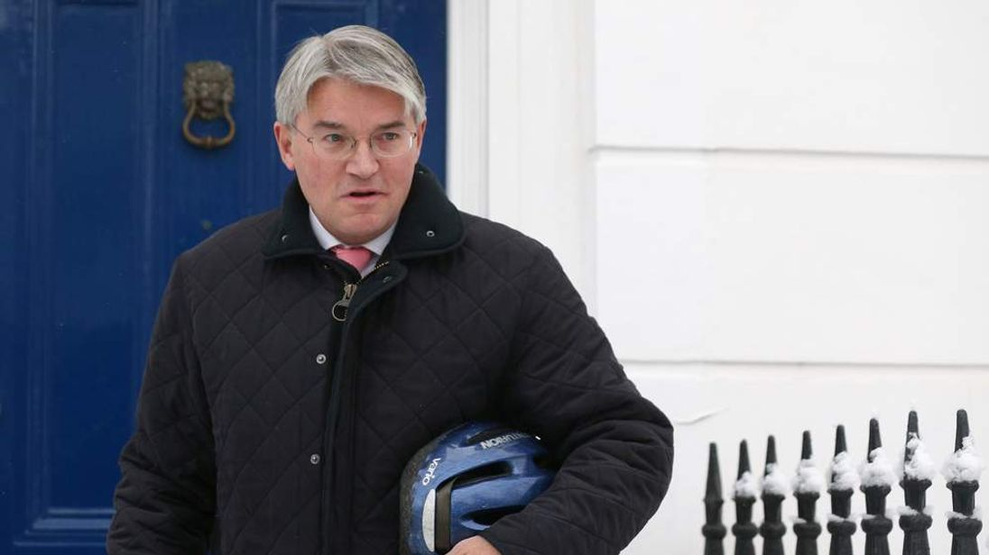 Andrew Mitchell outside his home