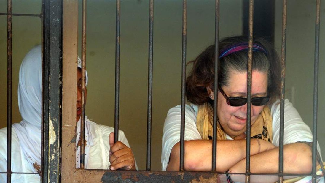 Lindsay June Sandiford (R) of Britain reacts inside a holding cell after her trial
