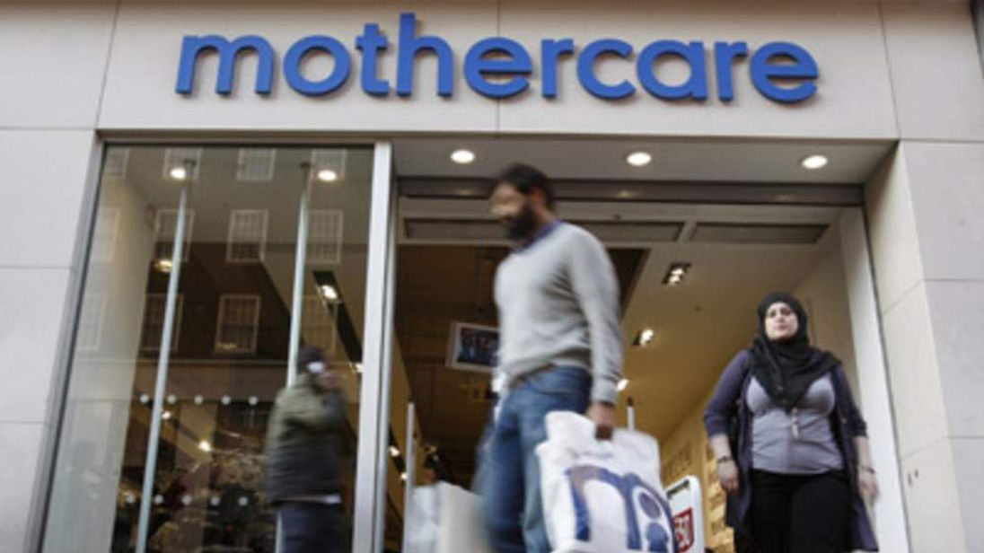 Customer leaving a Mothercare store in London