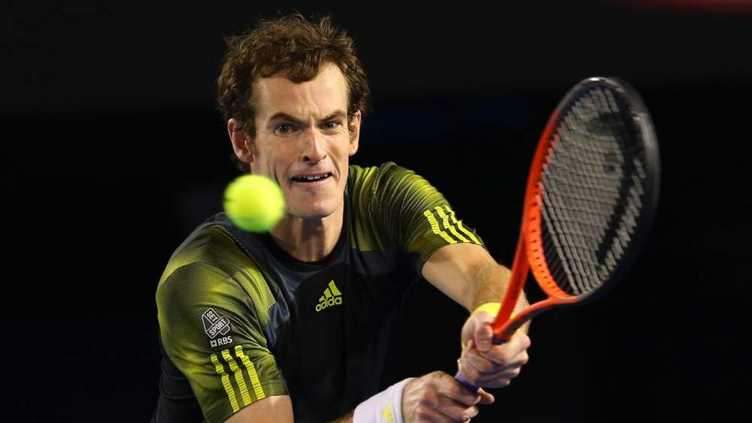 Andy Murray of Great Britain plays a backhand in his semifinal match against Roger Federer