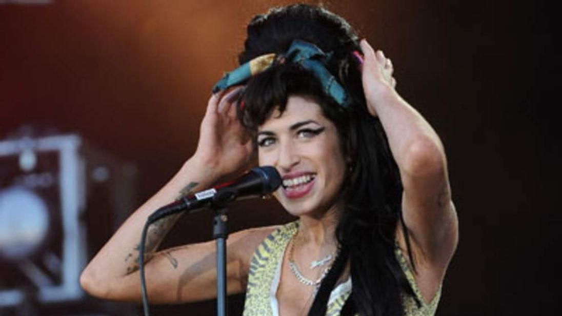 Amy Winehouse performs on stage for Rock in Rio