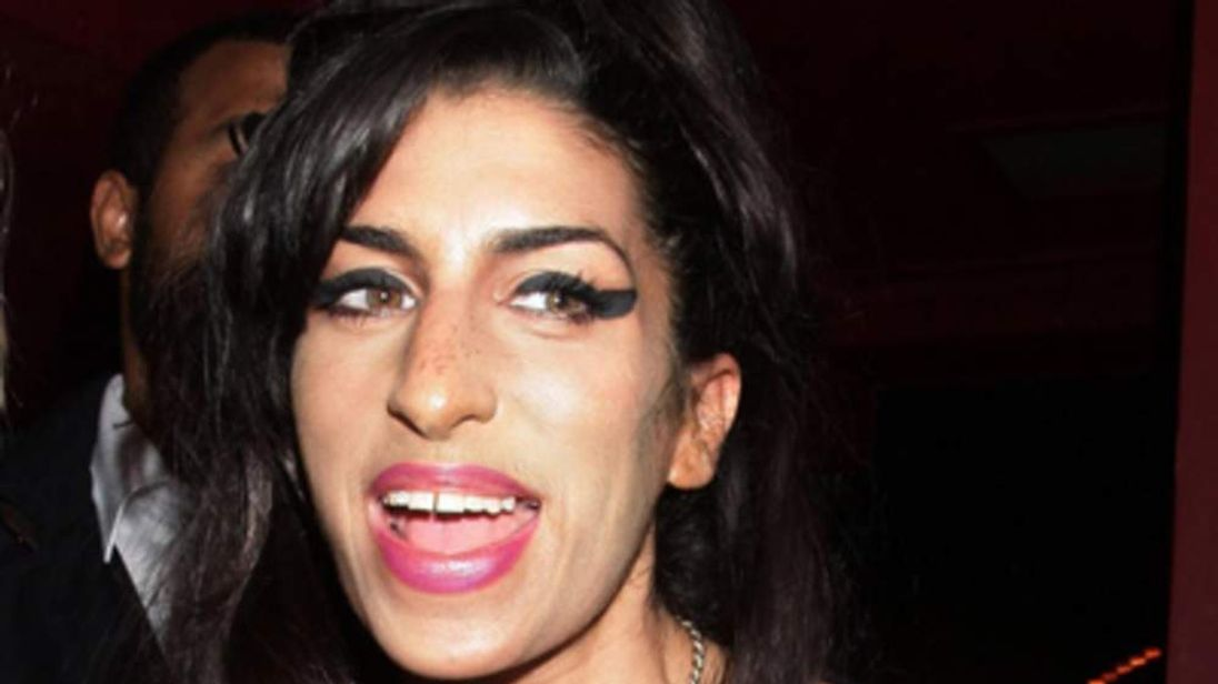 "Amy Winehouse's family say they have been left ""bereft"" by her death."