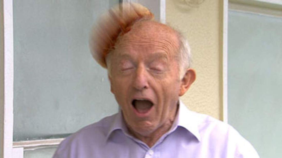 Paul Daniels is struck by a pizza thrown by the puppet Sooty