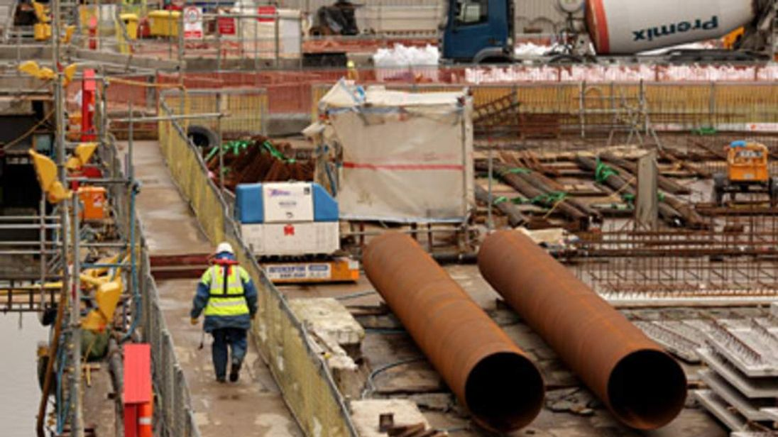 Construction workers build the Canary Wharf Crossrail Station