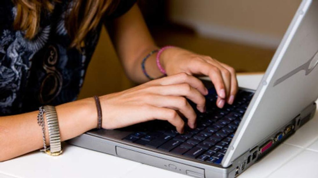 A teenager girl using her computer