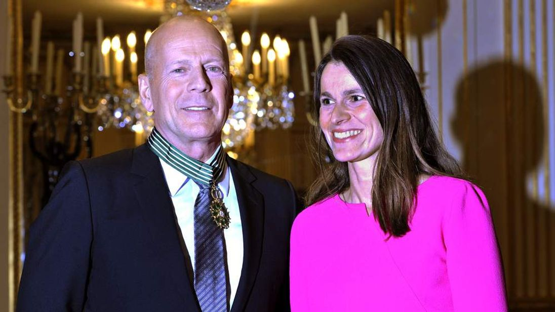 Bruce Willis poses with French Culture Minister Aurelie Filippetti after becoming a Commandeur des Arts et lettres