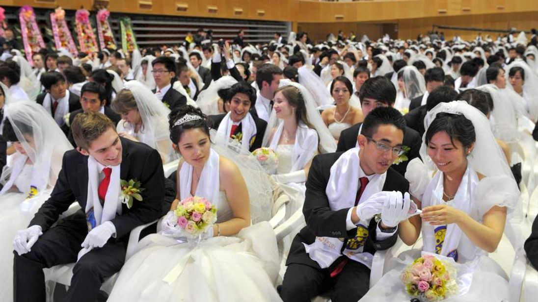 Thousands of couples marry at Unification Church's mass wedding in Seoul, South Korea