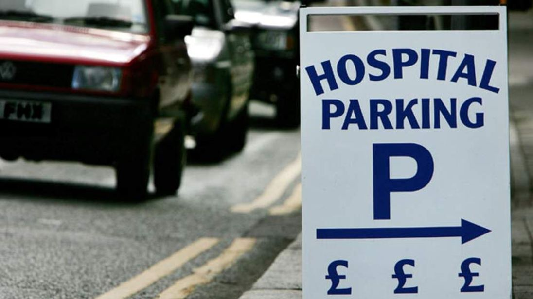 A sign giving directions to a charging hospital car park