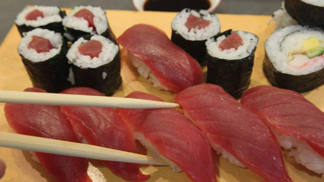 Sushi from yellowfin tuna on a customer's plate at a restaurant