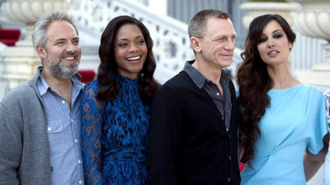 From left, Sam Mendes, Naomie Harris, Daniel Craig and Berenice Marlohe