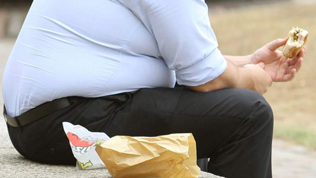Obese Man Eats Fast Food Generic