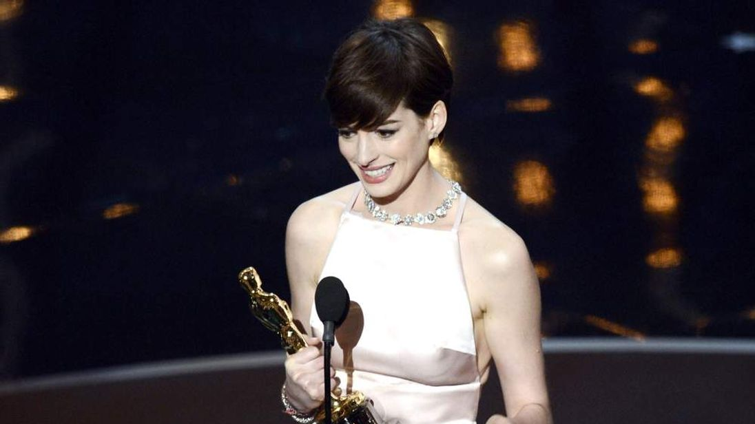 "Actress Anne Hathaway accepts the Best Supporting Actress award for ""Les Miserables"""