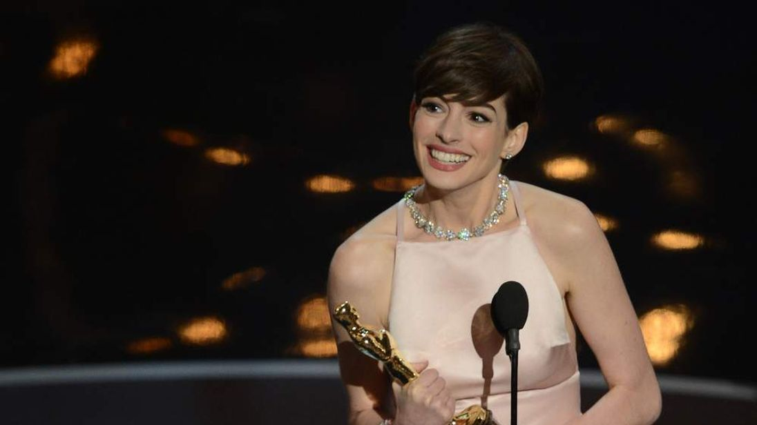 Best Supporting Actress winner Anne Hathaway addresses the audience onstage at the 85th Annual Academy Award