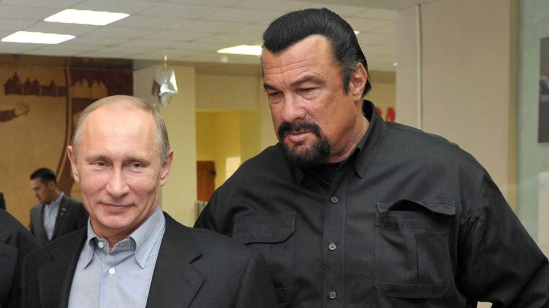 Steven Seagal and President Vladimir Putin visit Moscow wrestling school in March.
