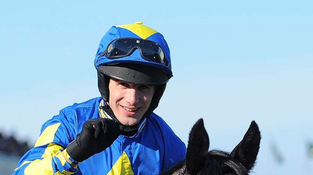 Ryan Mania rides to victory on Auroras Encore in the Grand National